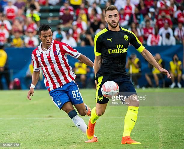 Calum Chambers of Arsenal battles Daniel Gonzalez of Guadalajaraduring the friendly match between Arsenal and CD Guadalajara at StubHub Center on...