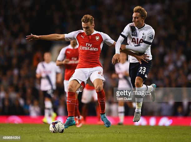 Calum Chambers of Arsenal battles with Christian Eriksen of Tottenham Hotspur during the Capital One Cup third round match between Tottenham Hotspur...