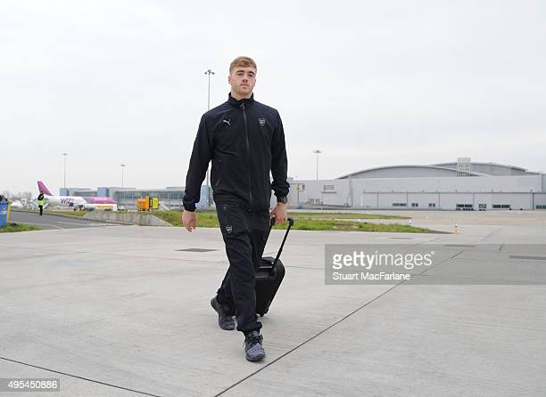 Calum Chambers of Arsenal boards the team flight to Munich at Luton Airport on November 3 2015 in Luton England