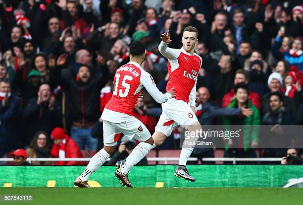 Calum Chambers of Arsenal celebrates scoring his team's first goal with his team mate Alex OxladeChamberlain during the Emirates FA Cup Fourth Round...