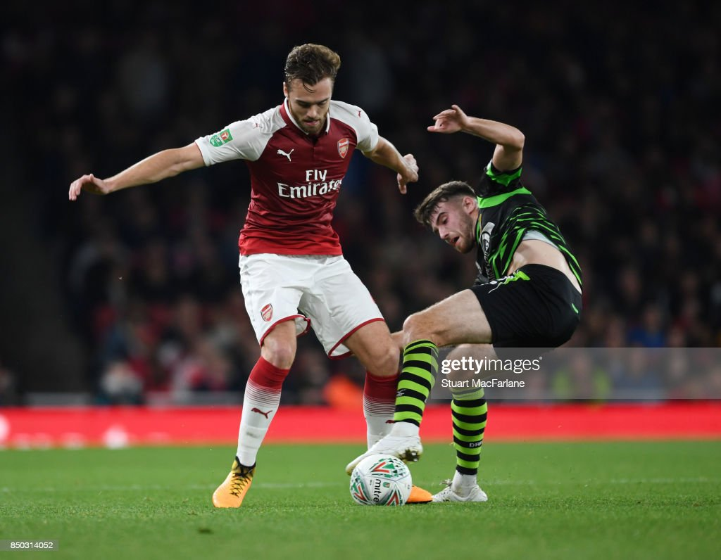 Calum Chambers of Arsenal challenged by Ben Whiteman of Doncaster during the Carabao Cup Third Round match between Arsenal and Doncaster Rovers at Emirates Stadium on September 19, 2017 in London, England.