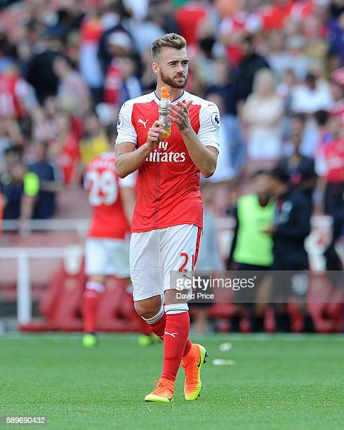 Calum Chambers of Arsenal claps the fans after the Premier League match between Arsenal and Liverpool at Emirates Stadium on August 14 2016 in London...