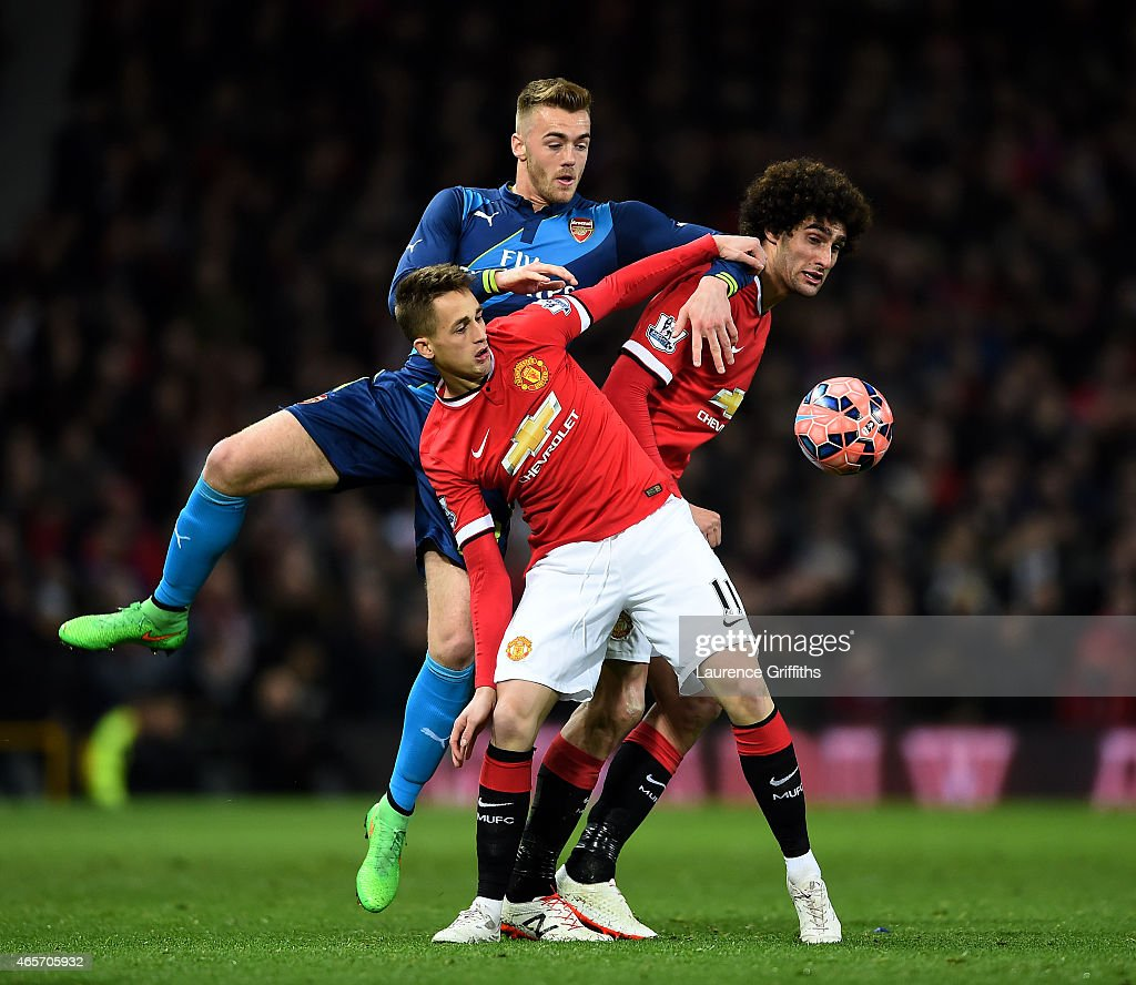 Calum Chambers of Arsenal competes for the ball with Adnan Januzaj of Manchester United and Marouane Fellaini of Manchester United during the FA Cup Quarter Final match between Manchester United and Arsenal at Old Trafford on March 9, 2015 in Manchester, England.