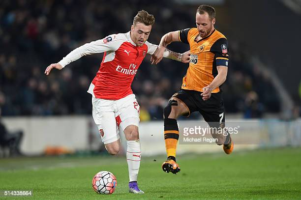 Calum Chambers of Arsenal is challenged by David Meyler of Hull City during the Emirates FA Cup Fifth Round Replay match between Hull City and...