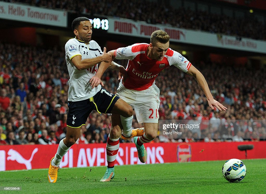 Calum Chambers (R) of Arsenal is fouled by Aaron Lennon of Tottenham during the Barclays Premier League match between Arsenal and Tottenham Hotspur at Emirates Stadium on September 27, 2014 in London, England.