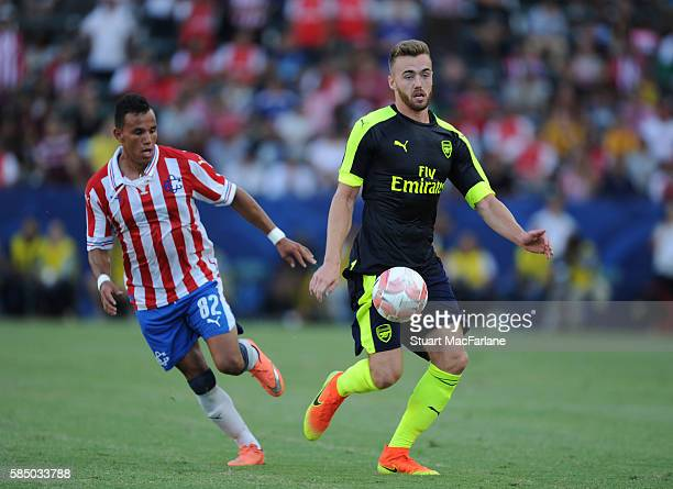 Calum Chambers of Arsenal takes on Daniel Gonzalez of Chivas during the pre season friendly match between Arsenal and CD Guadalajara at StubHub...