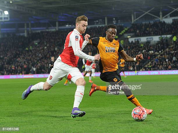 Calum Chambers of Arsenal takes on Moses Odubajo of Hull during the match between Hull City and Arsenal in the FA Cup 5th round at KC Stadium on...