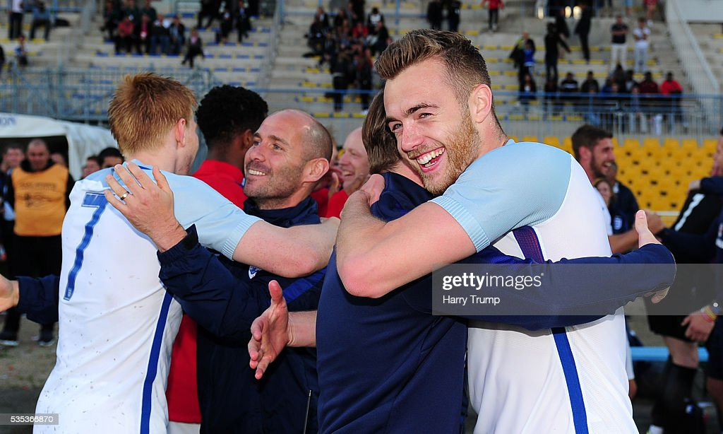 Calum Chambers of England (R) celebrates during the Final of the Toulon Tournament between England and France at Parc Des Sports on May 29, 2016 in Avignon, France.