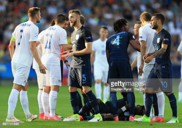 Calum Chambers of England exchanges words with Milan Skriniar of Slovakia during the UEFA European Under21 Championship Group A match between...