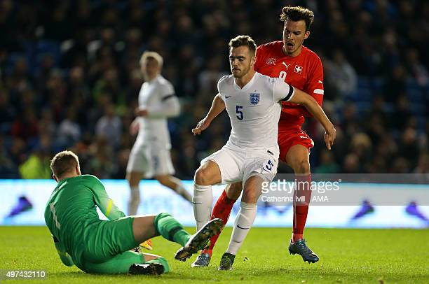 Calum Chambers of England U21 defends from Haris Tabakovic of Switzerland U21 as Jordan Pickford of England U21 comes into save during the UEFA U21...