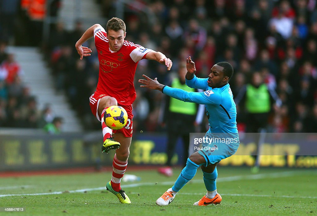 Calum Chambers of Southampton controls the ball under pressure from Danny Rose of Spurs during the Barclays Premier League match between Southampton and Tottenham Hotspur at St Mary's Stadium on December 22, 2013 in Southampton, England.