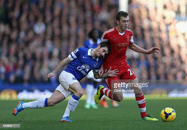 Calum Chambers of Southampton tangles with Leighton Baines of Everton during the Barclays Premier League match between Everton and Southampton at...
