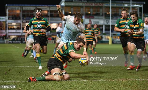 Calum Clark of Northampton dives over for a try during the Aviva Premiership match between Northampton Saints and Newcastle Falcons at Franklin's...