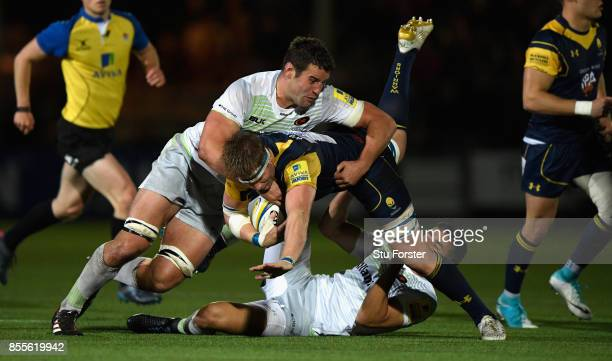 Calum Clark of Saracens tackles GJ Van Velze of Worcester during the Aviva Premiership match between Worcester Warriors and Saracens at Sixways...