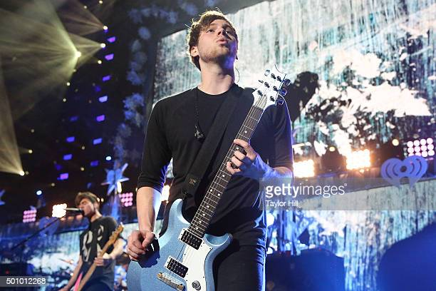 Calum Hood and Luke Hemmings of 5 Seconds of Summer perform during the 2015 Z100 Jingle Ball at Madison Square Garden on December 11 2015 in New York...