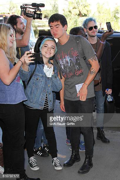 Calum Hood and Michael Clifford of 5 Seconds of Summer are seen at LAX on February 16 2016 in Los Angeles California