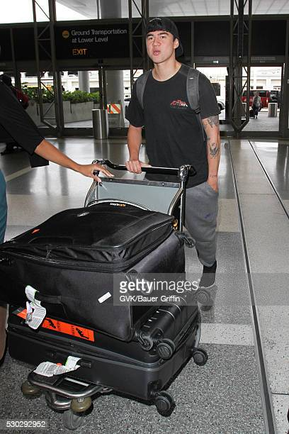 Calum Hood is seen at LAX on May 10 2016 in Los Angeles California
