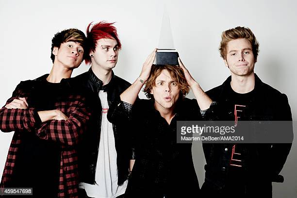 Calum Hood Michael Clifford Ashton Irwin and Luke Hemmings of 5 Seconds of Summer attend the 2014 American Music Awards Official Portrait Studio at...