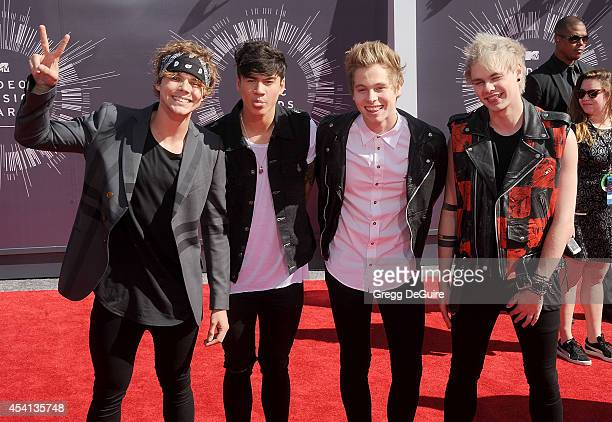 Calum Hood Michael Clifford Luke Hemmings and Ashton Irwin of 5 Seconds Of Summer arrive at the 2014 MTV Video Music Awards at The Forum on August 24...