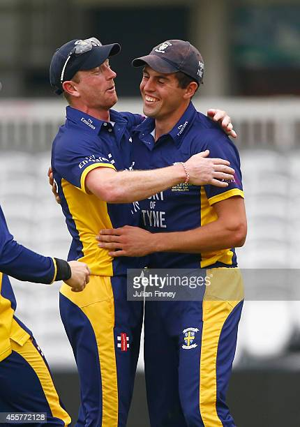Calum MacLeod is congratulated by Paul Collingwood of Durham after he caught out Chris Woakes of Warwickshire off the bowlng of Gareth Breese of...