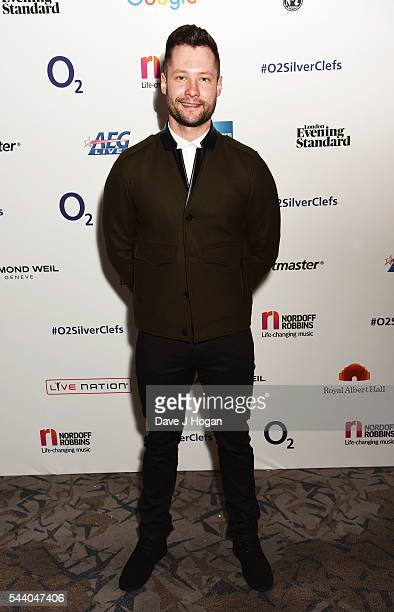 Calum Scott poses for a photo during the Nordoff Robbins O2 Silver Clef Awards on July 1 2016 in London United Kingdom