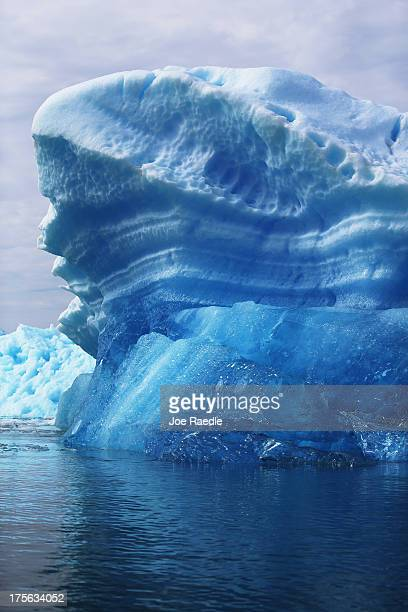 Calved icebergs from the nearby Twin Glaciers are seen floating on the water on July 30 2013 in Qaqortoq Greenland Boats are a crucial mode of...