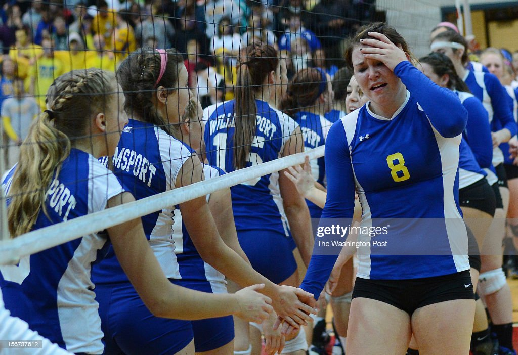 Calvert High School senior Lauren Carman, right, tears up as she shakes hands with Williamsport players after losing the Maryland High School Class 2A volleyball state championship game at Ritchie Coliseum on Monday, November 19, 2012.