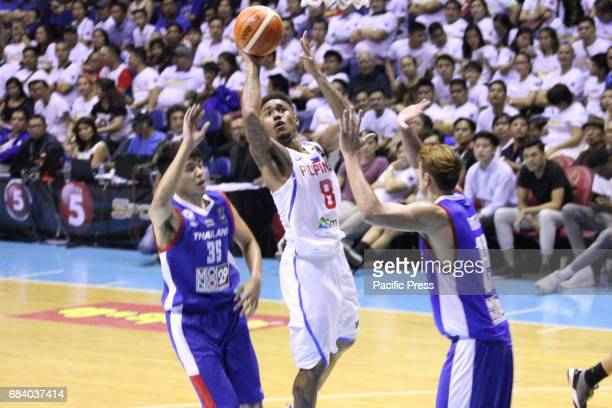 Calvin Abueva of the Philippines tries to get a shot off drawing two defenders Anuruk Lodlian and Sukhdave Ghogar of Thailand Philippines drubs...