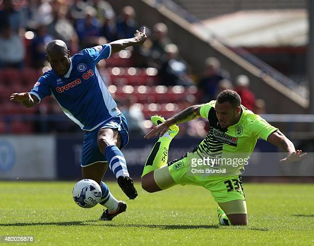 Calvin Andrew of Rochdale in action with Joel Lynch of Huddersfield Town during the pre season friendly match between Rochdale and Huddersfield Town...