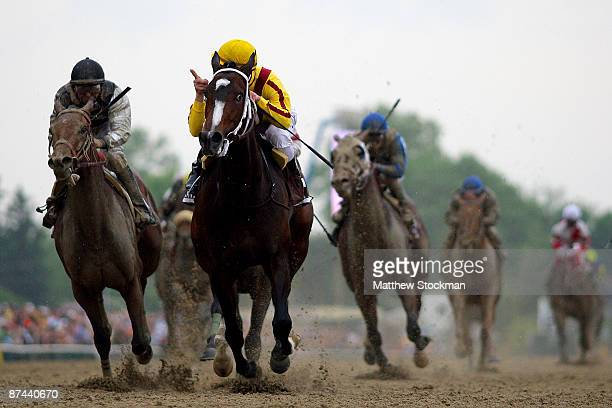 Calvin Borel riding Rachel Alexandra crosses the finish line ahead of Mine That Bird to win the 134th Preakness Stakes at Pimlico Race Course on May...