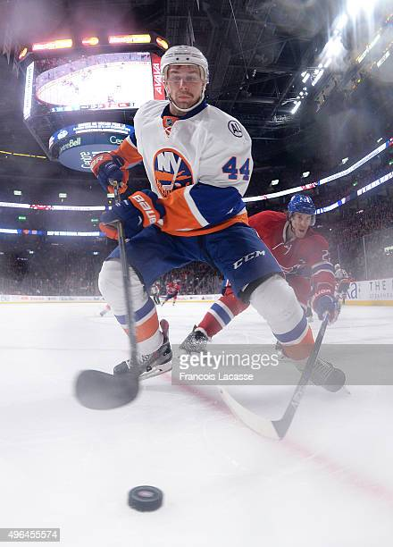 Calvin De Haan of the New York Islanders controls the puck against the Montreal Canadiens in the NHL game at the Bell Centre on November 5 2015 in...