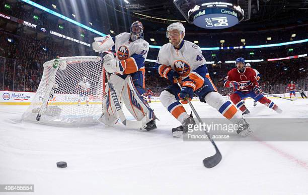 Calvin De Haan of the New York Islanders skates for the puck against the Montreal Canadiens in the NHL game at the Bell Centre on November 5 2015 in...