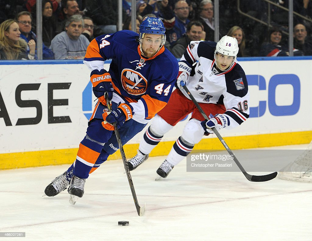 <a gi-track='captionPersonalityLinkClicked' href=/galleries/search?phrase=Calvin+de+Haan&family=editorial&specificpeople=5660177 ng-click='$event.stopPropagation()'>Calvin de Haan</a> #44 of the New York Islanders skates with the puck against <a gi-track='captionPersonalityLinkClicked' href=/galleries/search?phrase=Derick+Brassard&family=editorial&specificpeople=540468 ng-click='$event.stopPropagation()'>Derick Brassard</a> #16 of the New York Rangers during the third period on January 31, 2014 at Madison Square Garden in New York City.