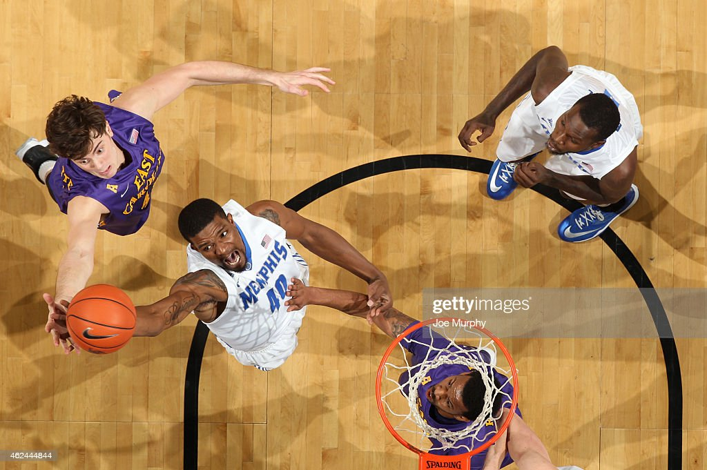 Calvin Godfrey of the Memphis Tigers jumps for a rebound against Marshall Guilmette of the East Carolina Pirates on January 28 2015 at FedExForum in...