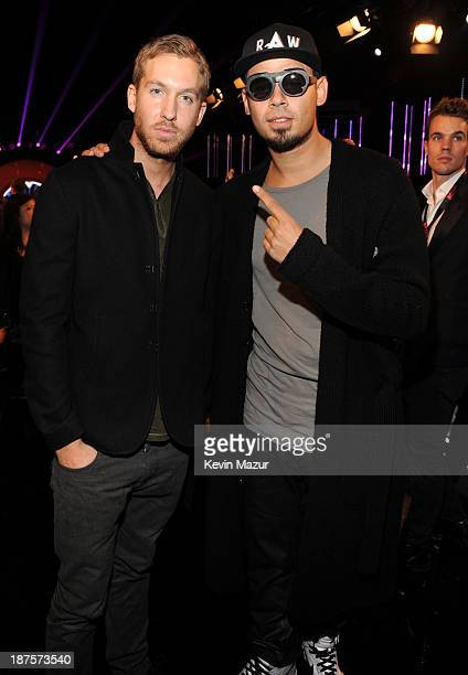 Calvin Harris and Afrojack attend the MTV EMA's 2013 at the Ziggo Dome on November 10 2013 in Amsterdam Netherlands