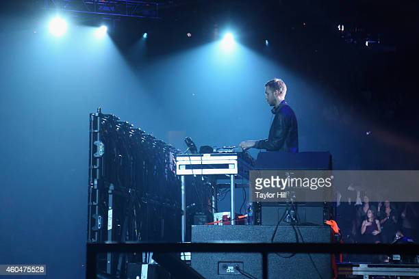 Calvin Harris performs onstage during KISS 108's Jingle Ball 2014 presented by Market Basket Supermarkets at TD Garden on December 14 2014 in Boston...