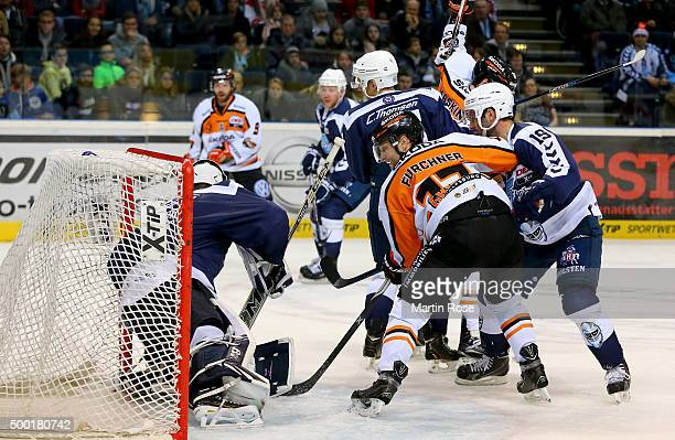 Calvin Heeter goaltender of Hamburg Freezers makes a save on Sebastian Furchner of Grizzly Wolfsburg during the DEL game between Hamburg Freezers and...
