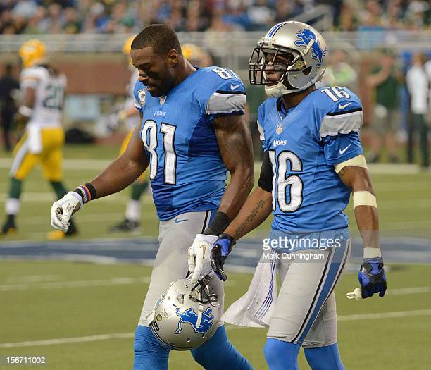 Calvin Johnson and Titus Young of the Detroit Lions walk off the field during the game against the Green Bay Packers at Ford Field on November 18...