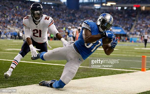 Calvin Johnson of the Detroit Lions catches a first quarter pass out of bounds while being defended by Ryan Mundy of the Chicago Bears in the first...