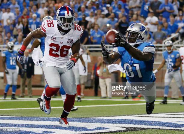Calvin Johnson of the Detroit Lions catches a first quarter touchdown next to Antrel Rolle of the New York Giants at Ford Field on September 8 2014...