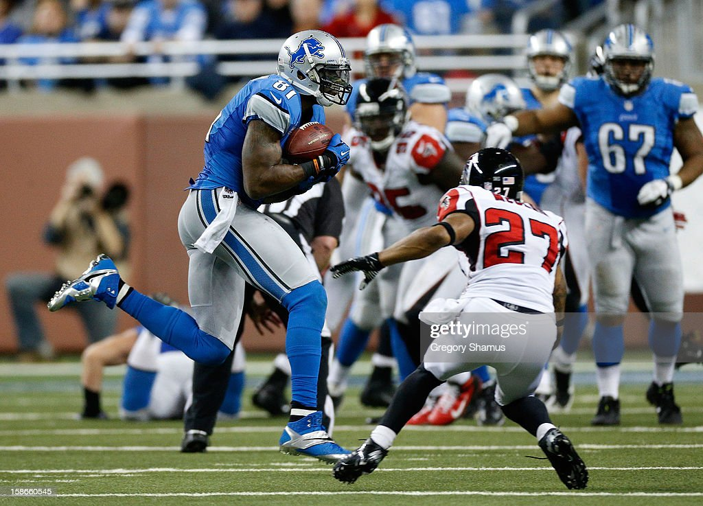 Calvin Johnson #81 of the Detroit Lions catches a fourth quarter 26-yard pass in front of Robert McClain #27 of the Atlanta Falcons at Ford Field on December 22, 2012 in Detroit, Michigan. Johnson broke the NFL single season yardage record formally held by Jerry Rice during this play.