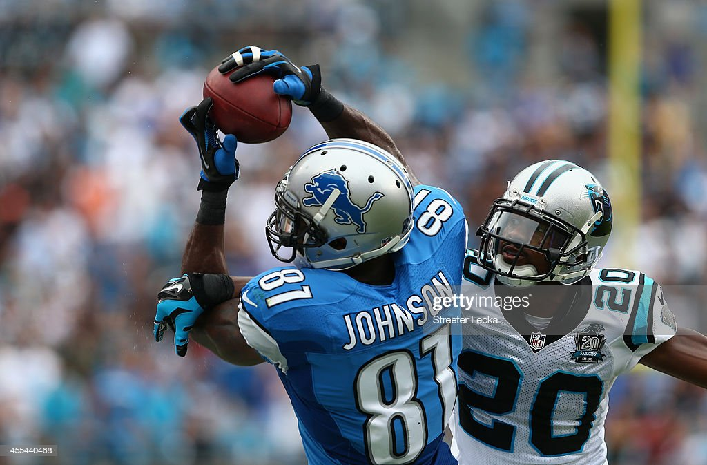 <a gi-track='captionPersonalityLinkClicked' href=/galleries/search?phrase=Calvin+Johnson+-+American+Football+Player&family=editorial&specificpeople=2253942 ng-click='$event.stopPropagation()'>Calvin Johnson</a> #81 of the Detroit Lions catches the ball against <a gi-track='captionPersonalityLinkClicked' href=/galleries/search?phrase=Antoine+Cason&family=editorial&specificpeople=2803078 ng-click='$event.stopPropagation()'>Antoine Cason</a> #20 of the Carolina Panthers during the game at Bank of America Stadium on September 14, 2014 in Charlotte, North Carolina.