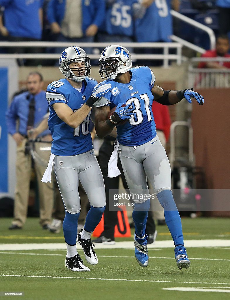 Calvin Johnson #81 of the Detroit Lions celebrates after breaking the NFL single season yardage record formally held by Jerry Rice with teammate Kris Durham #18 during the game against the Atlanta Falcons at Ford Field on December 22, 2012 in Detroit, Michigan. The Falcons defeated the Lions 31-18.