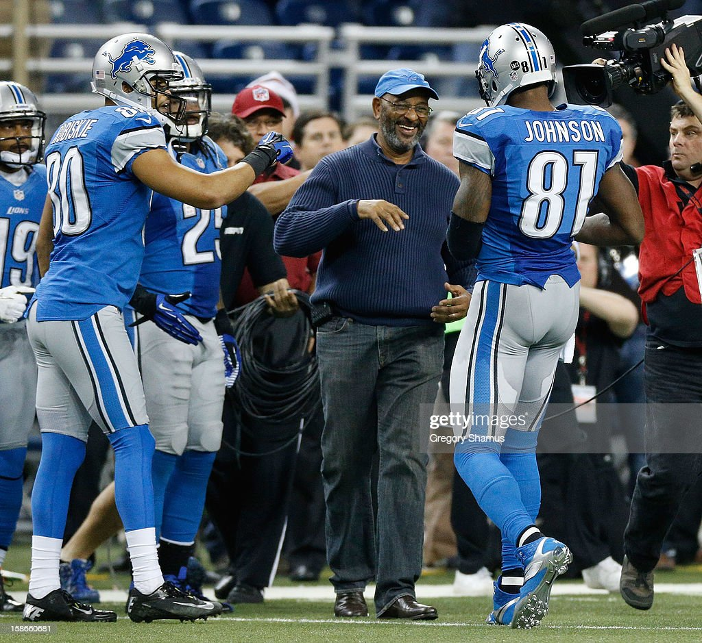 Calvin Johnson #81 of the Detroit Lions celebrates breaking the NFL single season yardage record formally held by Jerry Rice with his father Calvin Johnson Sr. while playing the Atlanta Falcons at Ford Field on December 22, 2012 in Detroit, Michigan.