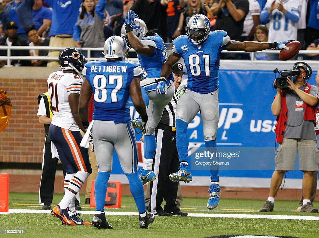 Calvin Johnson #81 of the Detroit Lions celebrates his second-quarter touchdown catch against the Chicago Bears at Ford Field on September 29, 2013 in Detroit, Michigan.