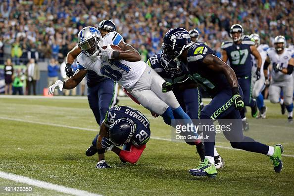 Calvin Johnson of the Detroit Lions dives for the end zone during the fourth quarter of a game against the Seattle Seahawks at CenturyLink Field on...