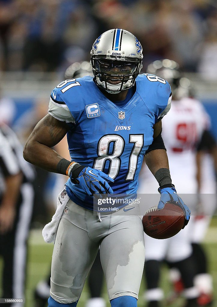 Calvin Johnson #81 of the Detroit Lions runs back to the huddle after breaking the NFL single season yardage record formally held by Jerry Rice during the game against the Atlanta Falcons at Ford Field on December 22, 2012 in Detroit, Michigan. The Falcons defeated the Lions 31-18.