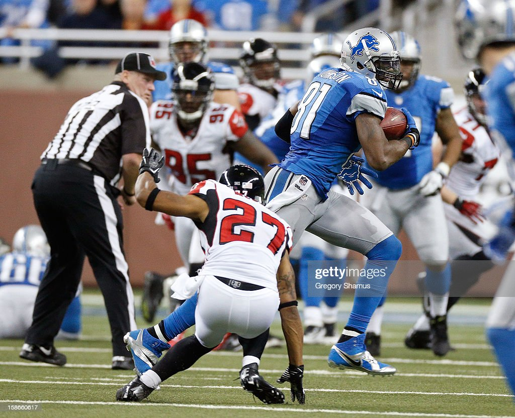 Calvin Johnson #81 of the Detroit Lions runs for 26 yards after a fourth quarter catch behind Robert McClain #27 of the Atlanta Falcons at Ford Field on December 22, 2012 in Detroit, Michigan. Johnson broke the NFL single season yardage record formally held by Jerry Rice during this play.