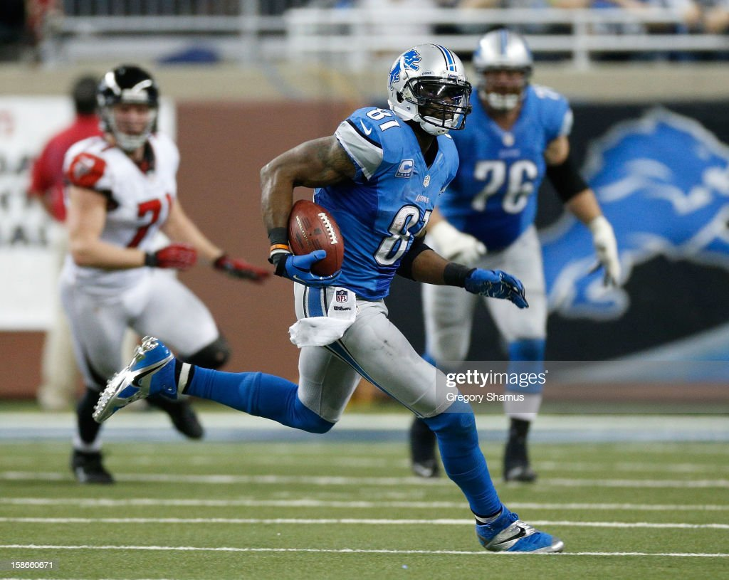 Calvin Johnson #81 of the Detroit Lions runs for 26 yards after a fourth quarter catch while playing the Atlanta Falcons at Ford Field on December 22, 2012 in Detroit, Michigan. Johnson broke the NFL single season yardage record formally held by Jerry Rice during this play.