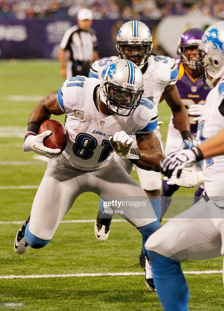 Calvin Johnson #81 of the Detroit Lions runs on a 11-yard touchdown catch against the Minnesota Vikings in the fourth quarter on November 11, 2012 at Mall of America Field at the Hubert H. Humphrey Metrodome in Minneapolis, Minnesota. The Vikings defeated the Lions 34-24.